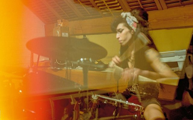 Amy playing drums at her Camden home, 2008. Credit: Blake Wood