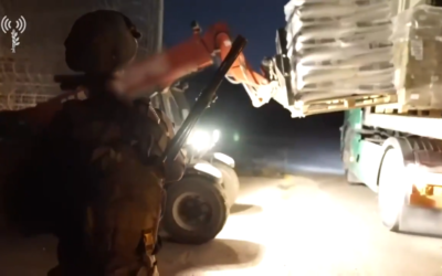 Screenshot from video of IDF soldiers helping distribute medicine, food and equipment to Syrians