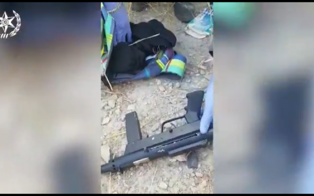 Screenshot from the Israeli police's video, showing the sub-machine guns being uncovered
