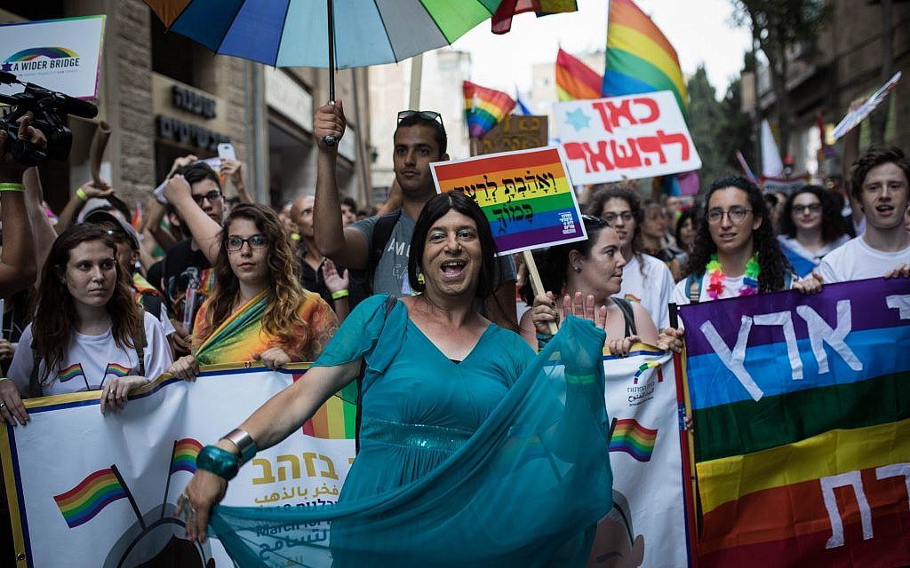 """Participants take part in the annual Jerusalem Gay Pride parade on August 2, 2018.   This year's parade, the 17th annual Jerusalem march, is being held under the banner of """"Pride and Tolerance"""". Photo by: JINIPIX"""