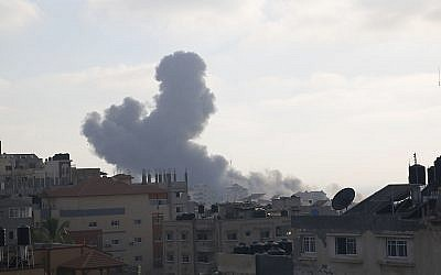 Smoke rises from an explosion caused by an Israeli airstrike in Gaza City, (AP Photo/Hatem Moussa)