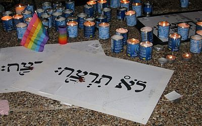 "Yahrzeit candles and signs entitled ""You shall not murder"" at the rally at Rabin Square on 8 August 2009."