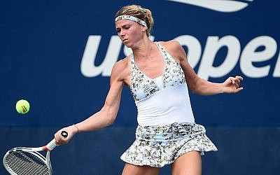 Camila Giorgi was beaten by Venus Williams in the second round of the US Open on Wednesday