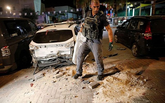 Israeli security cleans up the aftermath of a Palestinian rocket attack (Source: IDF spokesperson)
