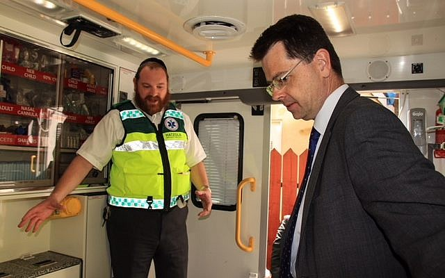 James Brokenshire with a strictly-Orthodox volunteer for emergency ambulance service Hatzola