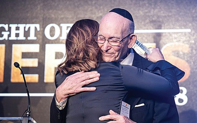 Norman Rosenbaum embracing Kerry Rosenfeld at the the Jewish News' Night of Heroes awards. He has now been honoured by the prime minister.   Credit: Blake Ezra.