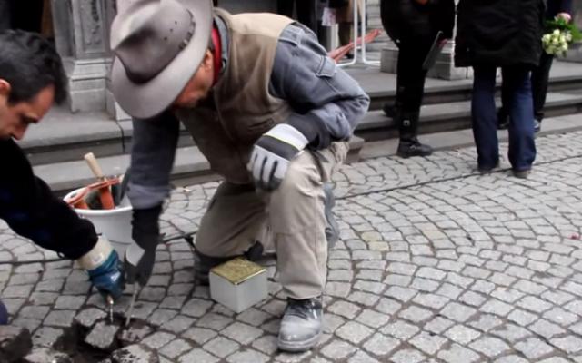 Demnig installs a Stolperstein in Cologne in 2013