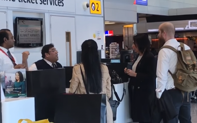Guests at at a Kuwait Airlines desk at Heathrow, being refused on to the plane