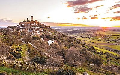 View of Monsaraz in Alentejo region, Portugal, at sunset.