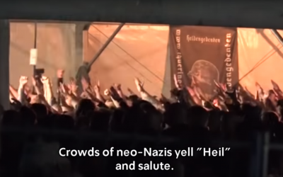 Crowd of neo-Nazis do Hitler salutes and chant 'heil Hitler' at the festival
