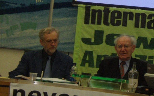Jeremy Corbyn with survivor Hajo Meyer at the talk in 2010. The banner in the background reads 'international Jewish Anti-Zionist Network'