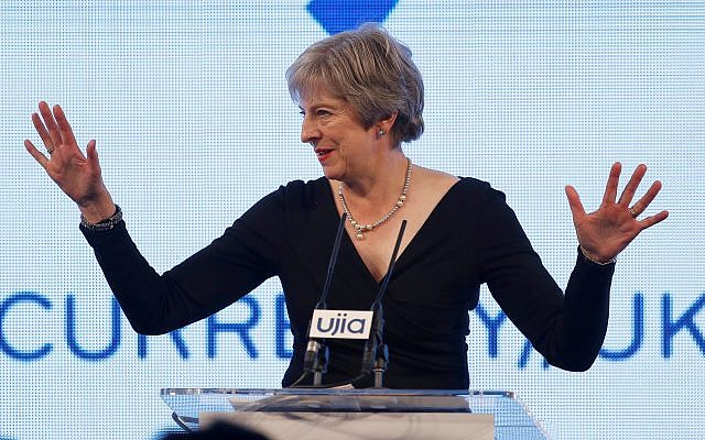 Prime Minister Theresa May acknowledges the audience before she speaks at the UJIA Appeal charity dinner in London. Photo credit: Peter Nicholls/PA Wire