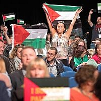 Delegates wave Palestinian flags at the Labour Party's annual conference. Photo credit: Stefan Rousseau/PA Wire