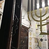 Image of the broken glass after a rock was hurled into the shul .Credit:  Sacha Dratwa on Facebook/ Courtesy GWŻ Gdańsk