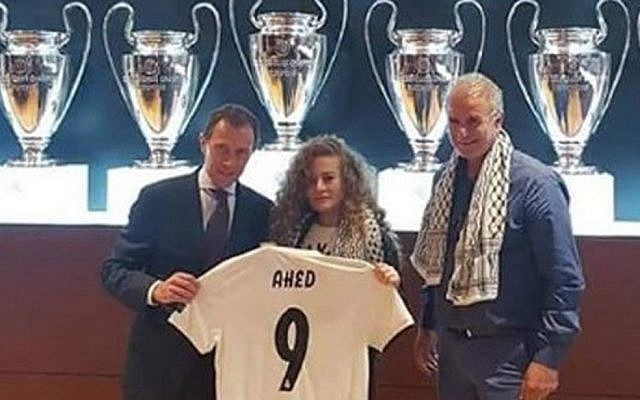Ahed Tamimi, pictured alongside club official Emilio Butragueño and her father