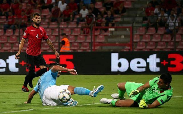 Brighton midfielder Beram Kayal challenges the Albanian goalkeeper during Israel's 1-0 defeat.
