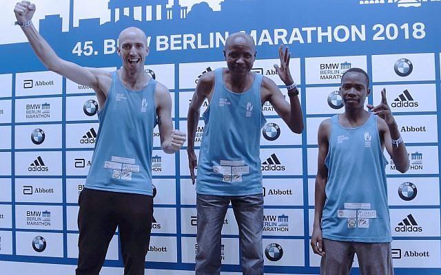 Athletes Fred Thackery-Vincent, Saidi Juma Makula  and Andrea Sipe Sambu on the podium, running for SACH