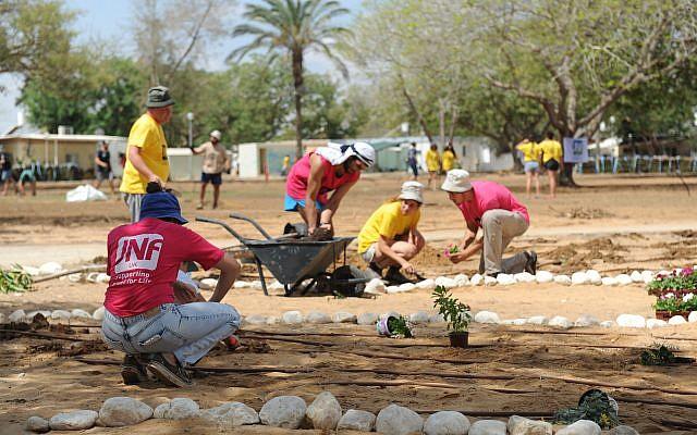 JNF volunteers help renovate the kibbutz