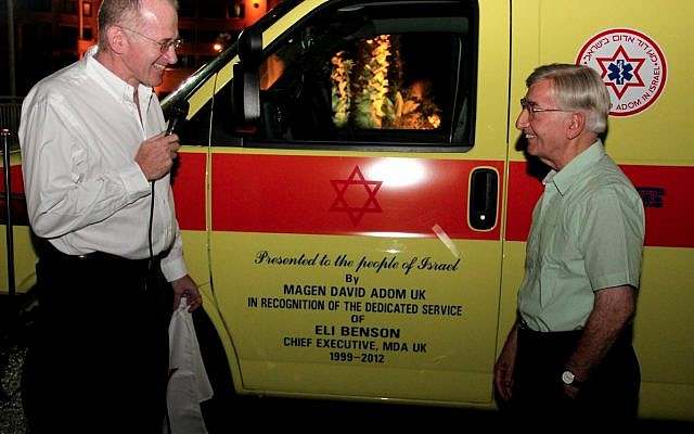 Eli Benson (right) with an ambulance dedicated in his name