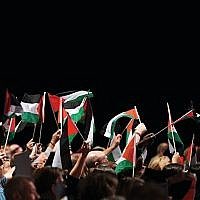Delegates hold up Palestinian flags during a debate on the third day of the Labour party conference in Liverpool, September 2018  (Photo creditOLI SCARFF/AFP/Getty Images)
