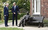 Prince William with local MP Ian Austin, next to the statue of Frank Foley.