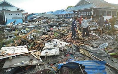 People survey the damage following a massive earthquake and tsunami in Palu, Central Sulawesi, Indonesia (AP Photo/Rifki)