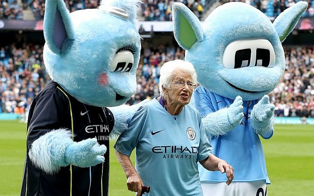 Vera Cohen poses with Manchester City mascots Moonchester and Moonbeam for photos having led the side out ahead of the their Premier League match against Fulham. Photo: Martin Rickett/PA Wire.