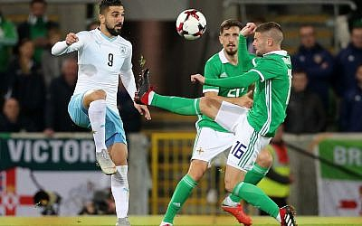 Israel's Moanes Dabour (left) and Northern Ireland's Oliver Norwood battle for the ball during the International Friendly at Windsor Park, Belfast. Photo credit should read: Liam McBurney/PA Wire