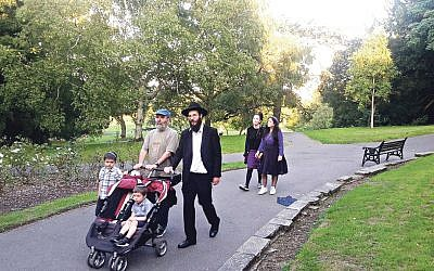 Rabbi Zalmy Blackman, with two of his sons