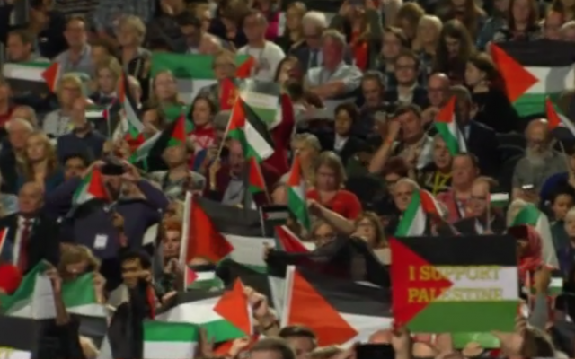 Palestinian flags fly during the Labour debate