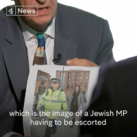 Jeremy Corbyn being confronted with an image of Luciana Berger with a police escort during the conference.