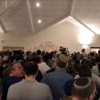 Screenshot from Facebook video of the funeral, attended by thousands