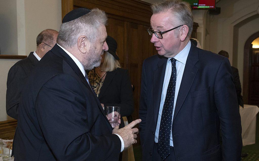 Rabbi Barry Marcus with Michael Gove MP  credit: Graham Chweidan