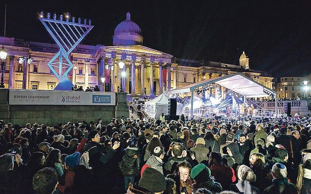 Chanukah in the Square, with the menorah in question on the left. (Credit: Yakir Zur)