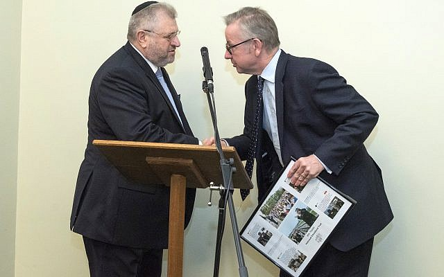 Environment secretary Michael Gove presenting Rabbi Barry Marcus with a framed picture from the Holocaust Educational Trust, thanking him for his work. credit: Graham Chweidan