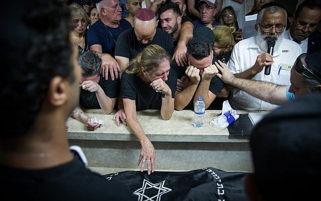 Family and friends attend the funeral of 28-year old Kim Levengrond Yehezkel in her hometown of Rosh haAyin on October 07, 2018. Yehezkel was shot dead earlier today by a Palestinian terrorist at the Barkan Industrial Park near the settlement-city of Ariel. A 35-year old Israeli man was also killed in the attack.  photo by: JINIPIX