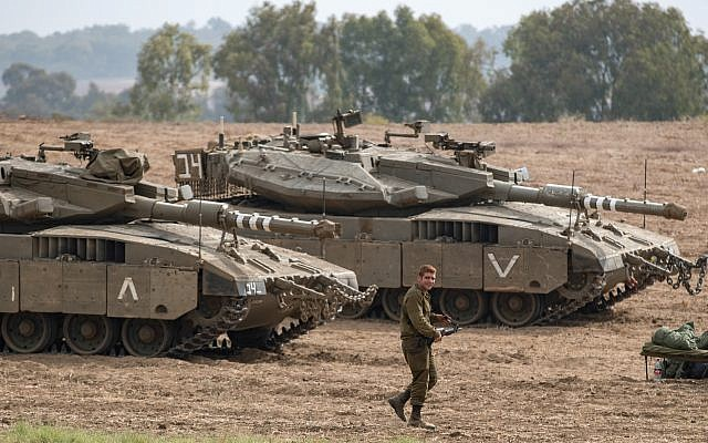 Israeli Merkava tanks are stationed in an open area near Israel's border with the Gaza Strip on October 19, 2018, after Gaza's Islamist rulers Hamas pledged to launch an investigation into rocket fire at Israel earlier this week, in an apparent bid to calm fears of a new war. Photo by: JINIPIX