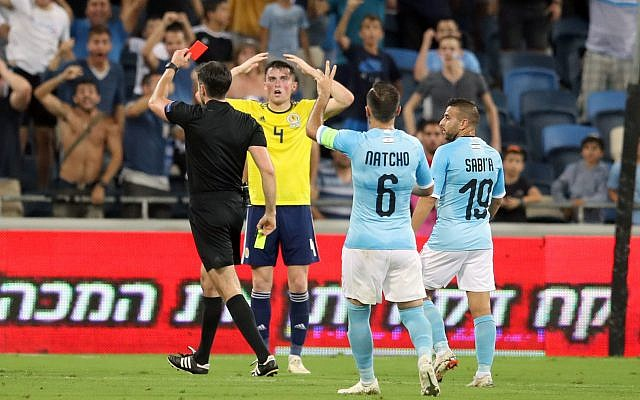 Scotland's Jon Soutattar is shown a red card during the UEFA Nations League Group C1 match at the Sammy Ofer Stadium, Haifa.  Photo credit: Adam Davy/PA Wire.