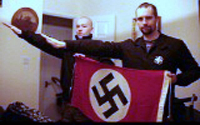 BEST QUALITY AVAILABLE  Undated handout photo issued by West Midlands Police of a picture shown to jurors at Birmingham Crown Court, showing Darren Fletcher (right) who has admitted being a member of banned far-right terrorist group National Action, posing with alleged member Adam Thomas, as both give a Nazi-style salute. PRESS ASSOCIATION Photo. Issue date: Sunday November 29, 2015. See PA story COURTS FarRight. Photo credit should read: West Midlands Police/PA Wire  NOTE TO EDITORS: This handout photo may only be used in for editorial reporting purposes for the contemporaneous illustration of events, things or the people in the image or facts mentioned in the caption. Reuse of the picture may require further permission from the copyright holder.