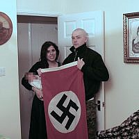 National Action members Adam Thomas and his partner Claudia Patatas with their new born baby, named Adolf, posing with a Swastika flag at their home in Waltham Gardens, Banbury, Oxfordshire.. Photo credit: West Midlands Police/PA Wire