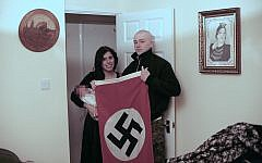 Handout issued by West Midlands Police of a picture shown to jurors at Birmingham Crown Court, showing alleged National Action members Adam Thomas and his partner Claudia Patatas with their new born baby, posing with a Swastika flag at their home in Waltham Gardens, Banbury, Oxfordshire.. Photo credit: West Midlands Police/PA Wire