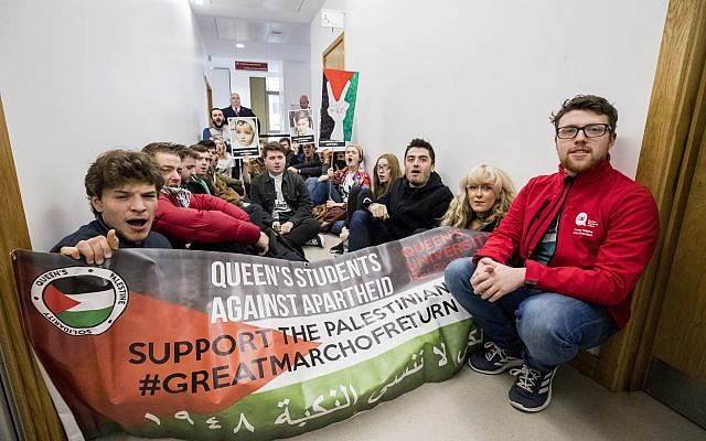 Students hold a sit-in protest at Queen's University, Belfast, during the visit of Israeli ambassador to the United Kingdom Mark Regev. Photo credit: Liam McBurney/PA Wire
