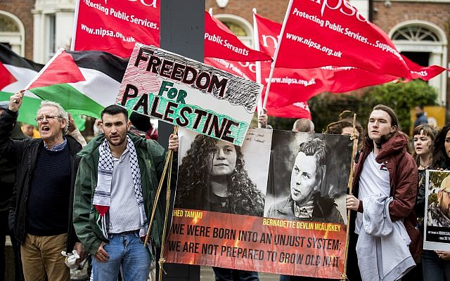 People protest outside Queen's University, Belfast, during the visit of Israeli ambassador to the United Kingdom Mark Regev.  Photo credit: Liam McBurney/PA Wire