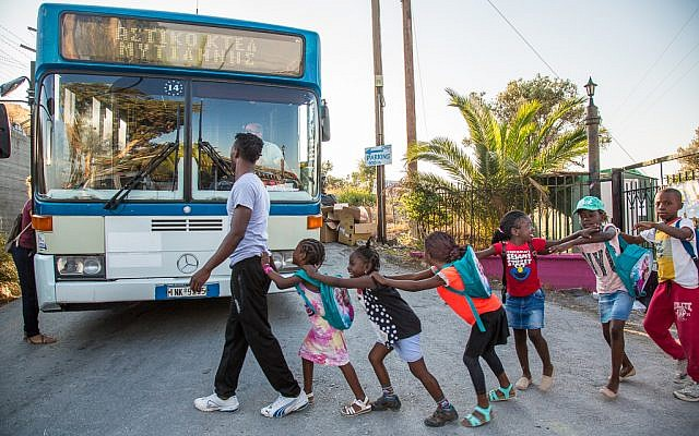 At the end of the school day, the students at the School of Peace return home to refugee camps. Photo - Lisa Kristine