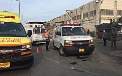 Emergency workers at the scene of the terror attack at the Barkan industrial area