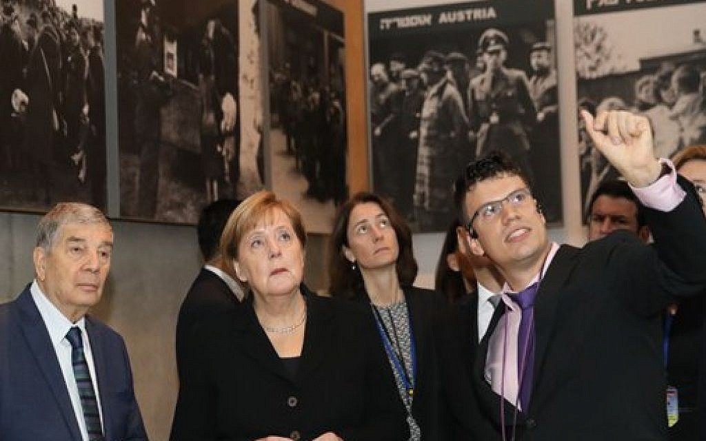 German Chancellor Angela Merkel during her state visit to Israel. Here she tours Israel national Holocaust memorial museum, Had Vashem. Credit: Had Vashem on Twitter