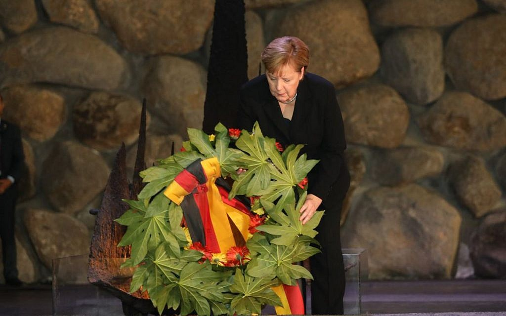 German Chancellor Angela Merkel lays a wreath during her visit to Israel's national Holocaust memorial museum, Had Vashem. Credit: Had Vashem on Twitter