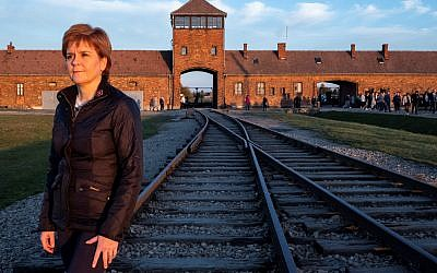 Nicola Sturgeon at Auschwitz, in front of the gate of death (Credit: Holocaust Educational Trust)