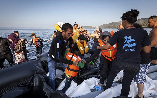 New Arrivals on the shores of Lesbos. Photo - Boaz Arad