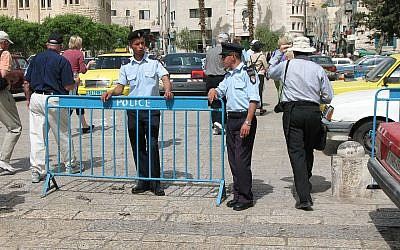 Two Palestinian police in front of Church of the Nativity. (Credit: James Emery via Wikimedia Commons)